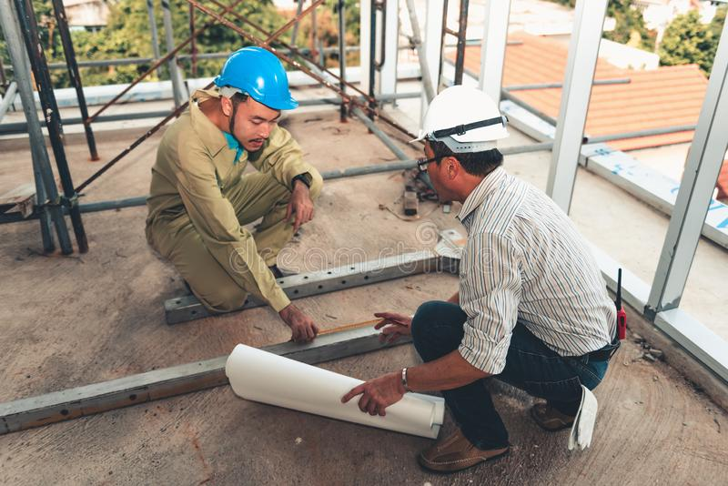 Engineer man is inspection materials for installation in construction site with his labor royalty free stock image