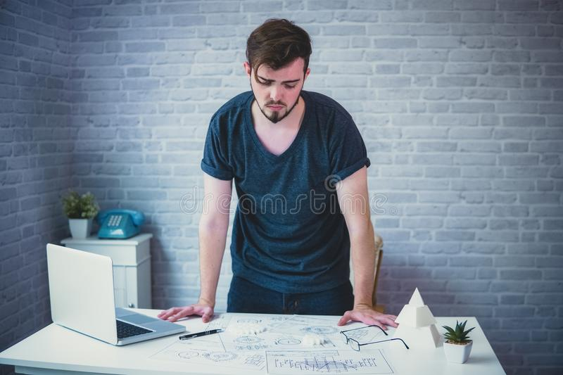 Engineer man working on blueprint for designing mechanical parts stock photography