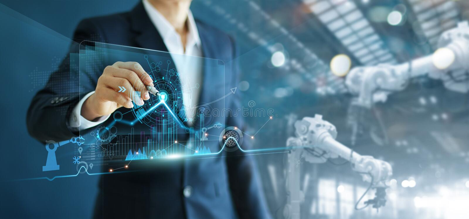 Engineer manager analyzing and control automation robot arms machine on software modern virtual interface data real time  in. Engineer manager  analyzing and royalty free stock image