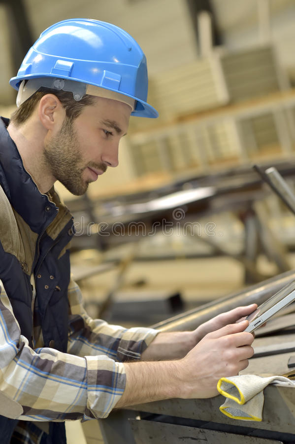 Engineer in metallurgic factory using tablet. Engineer in metallurgical factory using tablet royalty free stock photos