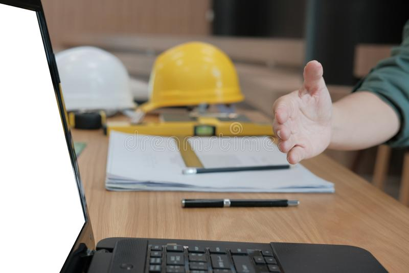 engineer offering handshake. architect ready to shake hand for b stock images