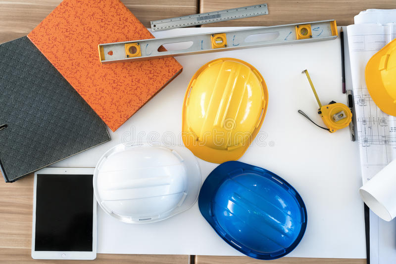 Engineer office desk background with construction project ideas stock image