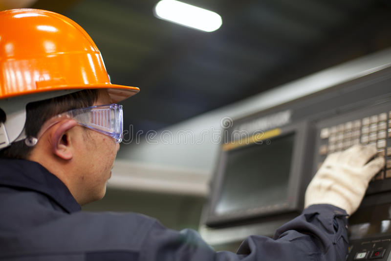 Engineer operating machine royalty free stock photos