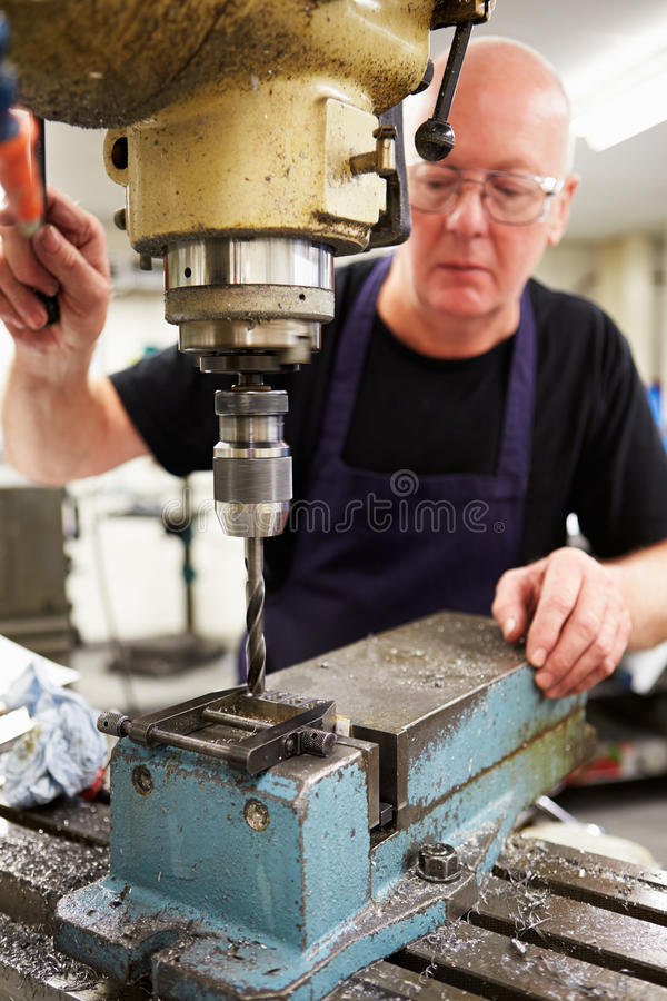 Engineer Operating Milling Machine In Factory stock photo