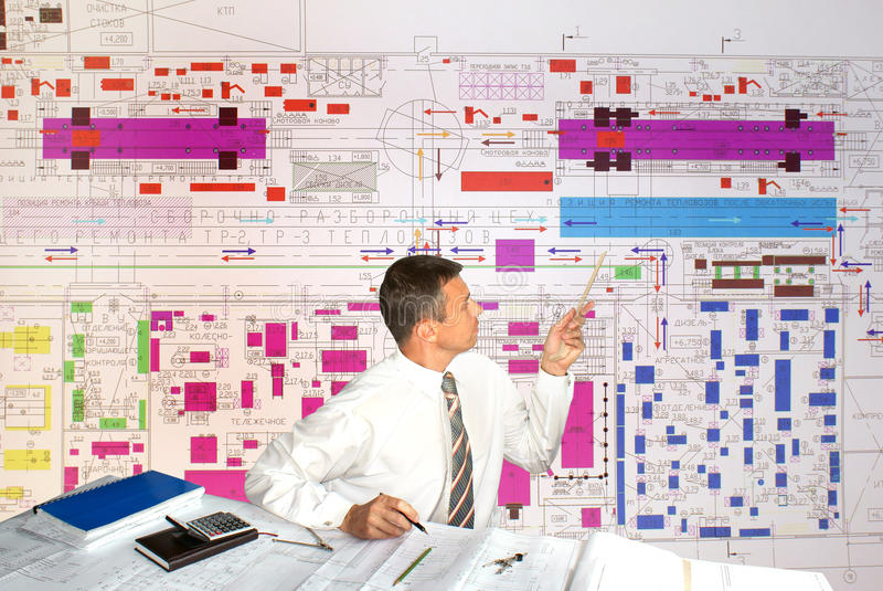 Engineer- planner. Projection -initial preparatory stage in construction new building royalty free stock images