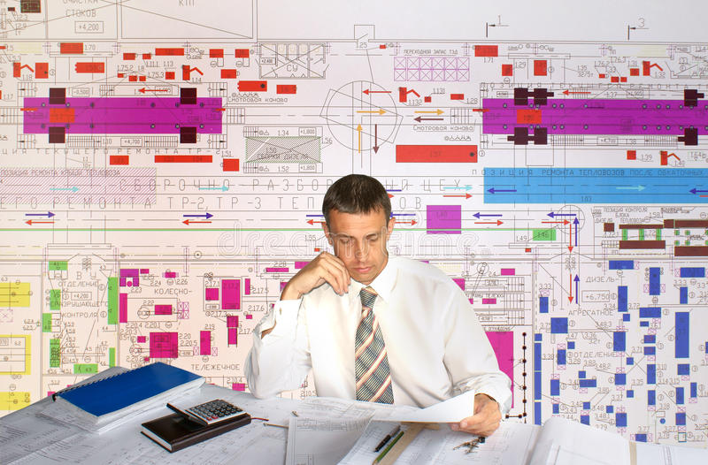 Engineer- planner. Projection -initial preparatory stage in construction new building stock photos