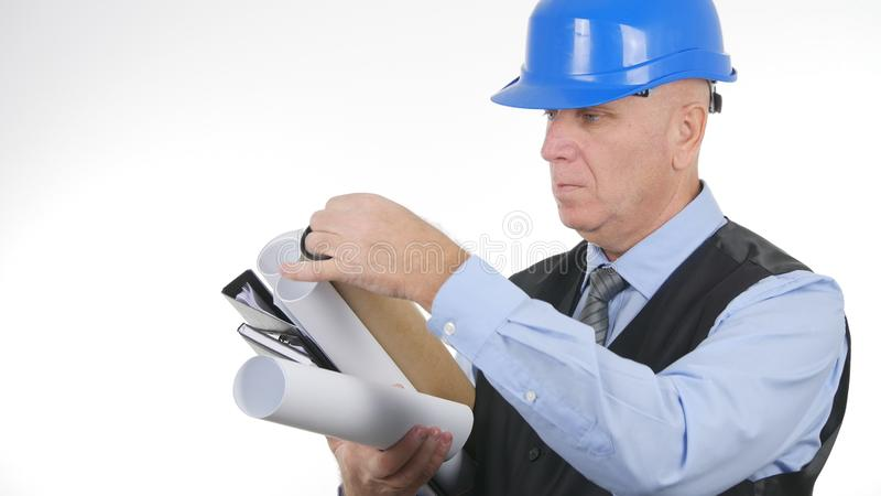 Engineer with Plans and Projects Going to a Meeting royalty free stock photo