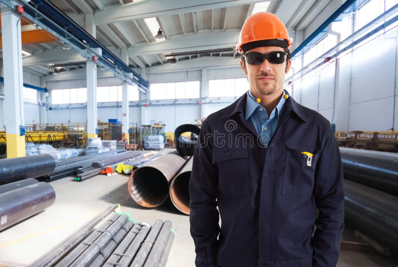 Engineer portrait in a factory royalty free stock photos