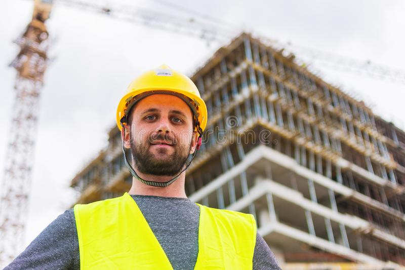 Building construction worker engineer posing royalty free stock image