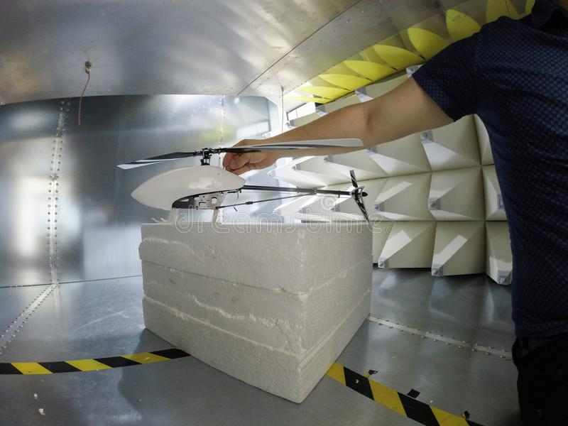 Engineer preparing for the Electromagnetic compatibility EMC test. Helicopter drone electromagnetic compatibility testing inside GTEM cell stock image