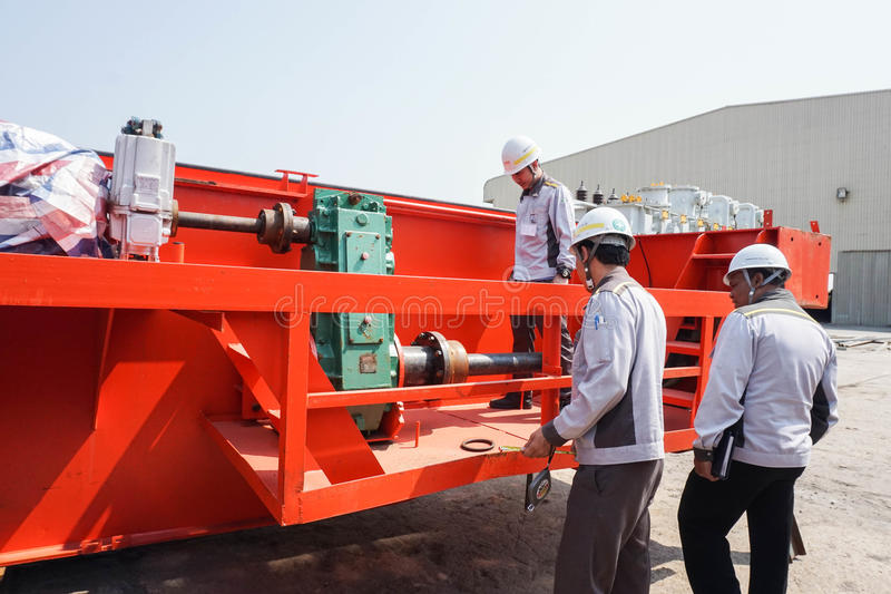 Engineer and QC team on duty repair the machinery of the crane royalty free stock photo