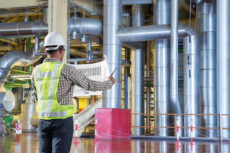 Engineer reading drawing diagram for maintance at thermal power royalty free stock photography
