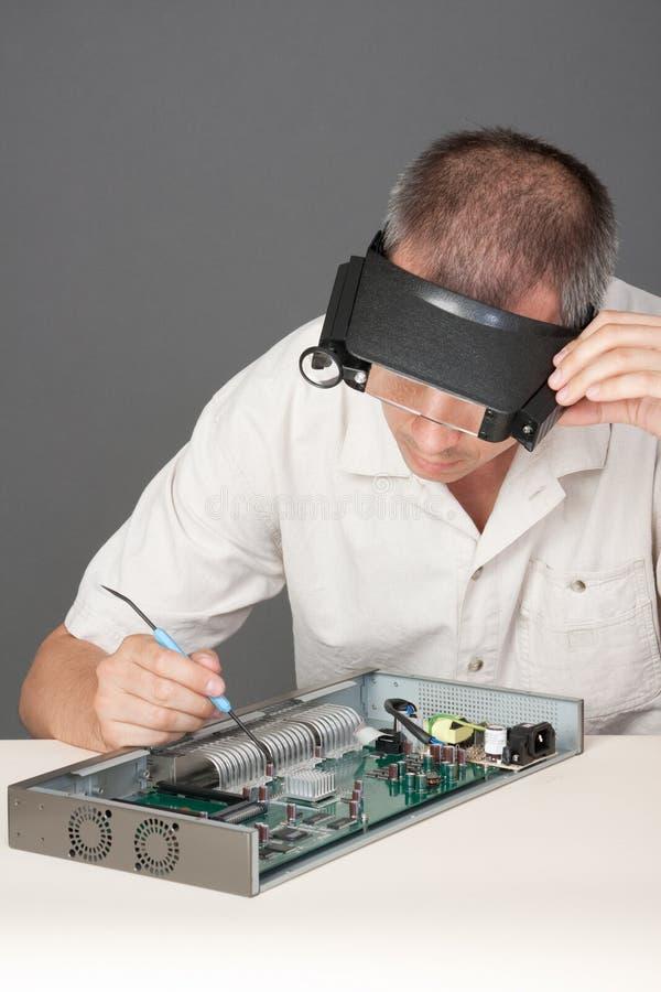 Engineer repairing circuit board royalty free stock photography