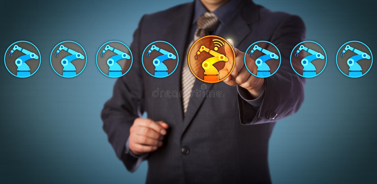 Engineer Selecting A Wireless Enabled Robotic Arm stock images