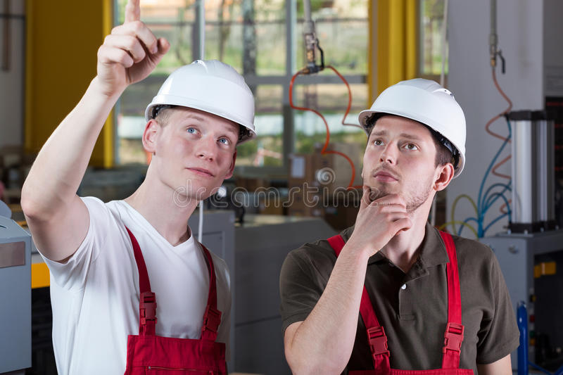 Engineer showing something at production area stock photography