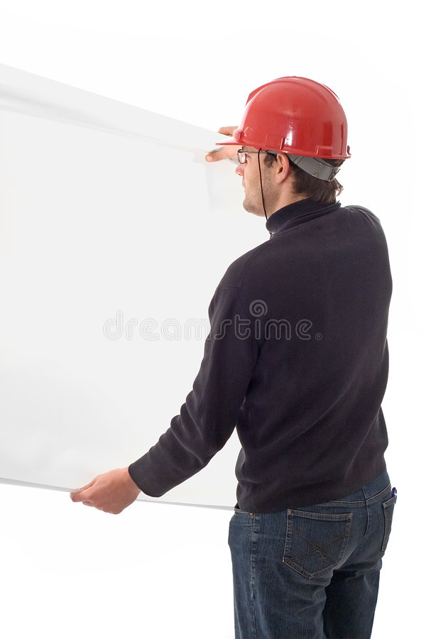Engineer, showing a white paper. Engineer in red hat, showing a blank white paper stock image