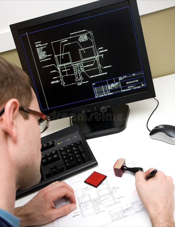 Engineer signing drawings royalty free stock image