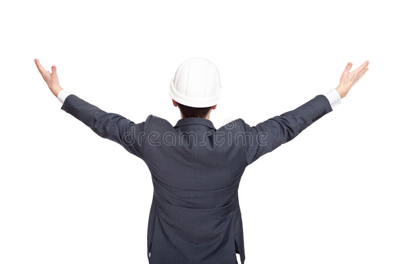 Engineer standing back view holding his arms up stock photos