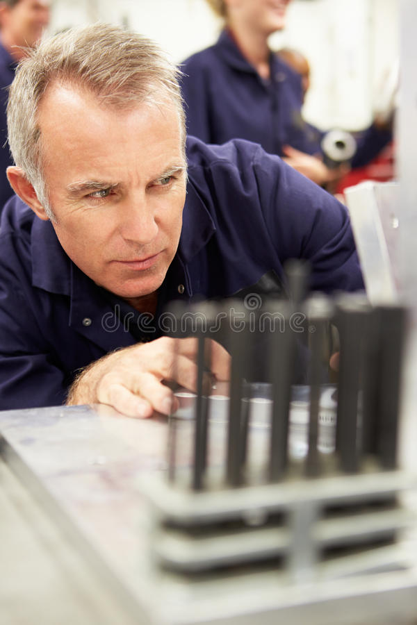 Engineer Studying Component In Workshop. Close Up Of Engineer Studying Component In Workshop stock photography