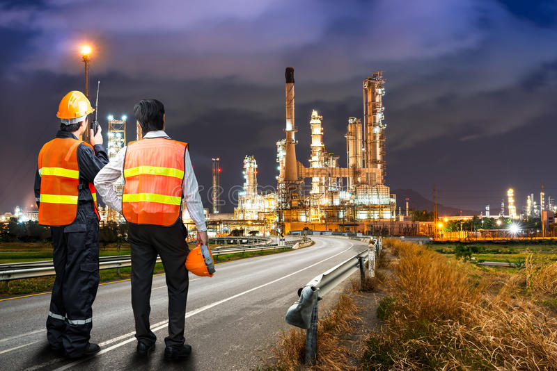 Engineer survey of oil refiner royalty free stock photography