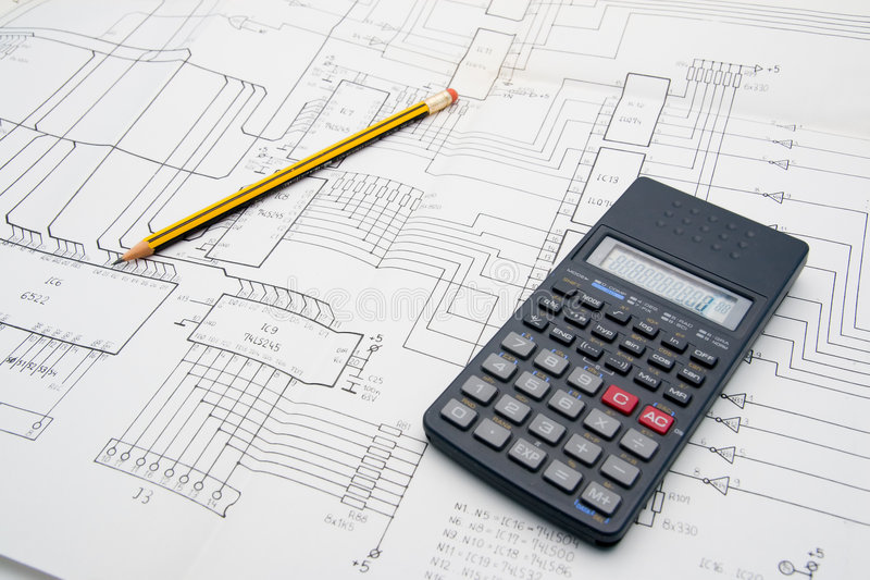 Engineer table design. With schematics, pencil and calculator royalty free stock photo