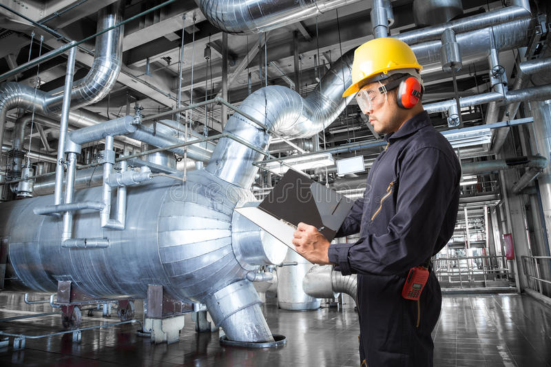 Engineer taking notes at thermal power plant factory.  royalty free stock images