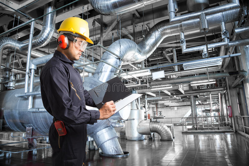 Engineer taking notes at thermal power plant factory.  stock image
