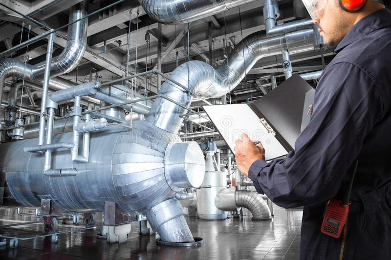 Engineer taking notes at thermal power plant factory.  royalty free stock photography