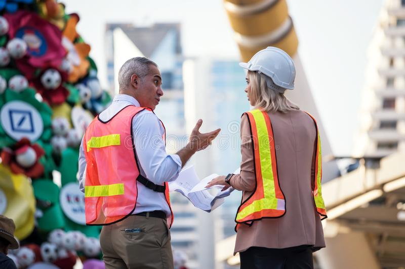 Engineer team discuss construction project at site royalty free stock images