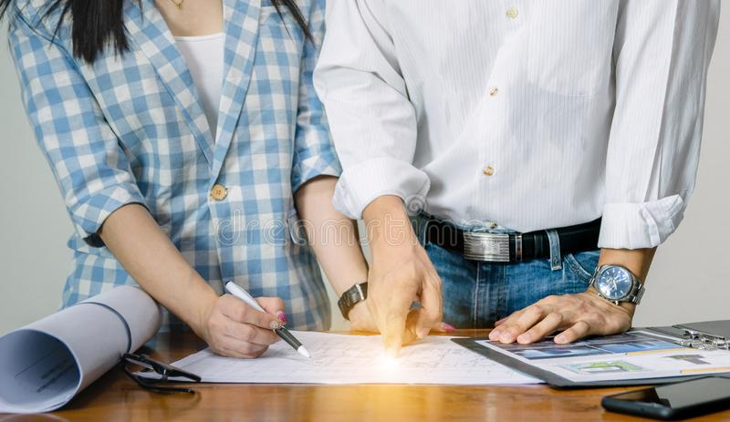 Engineer team work for the design of the plan. Building royalty free stock photo