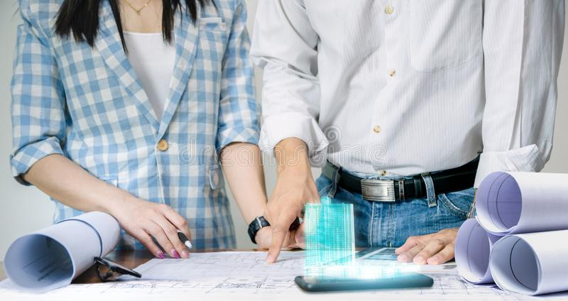 Engineer team work for the design of the sheet plan display technology building. Model royalty free stock photos