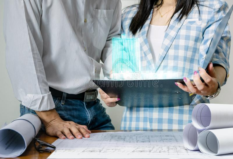 Engineer team work for the design of the sheet plan display technology building. Model stock photos