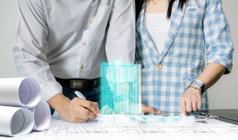 Engineer team work for the design of the sheet plan display technology building. Model stock images