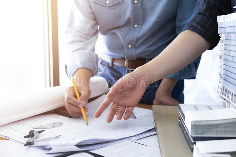 Engineer teamwork sketching a housing and building project. stock photo