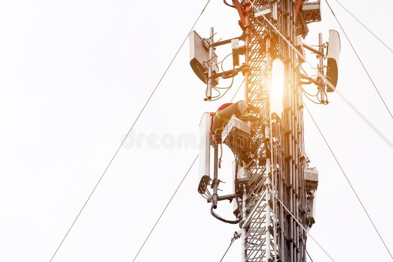 Engineer or Technician working on high tower,Risk work of high work, people are working with safety equipment on tower, royalty free stock images