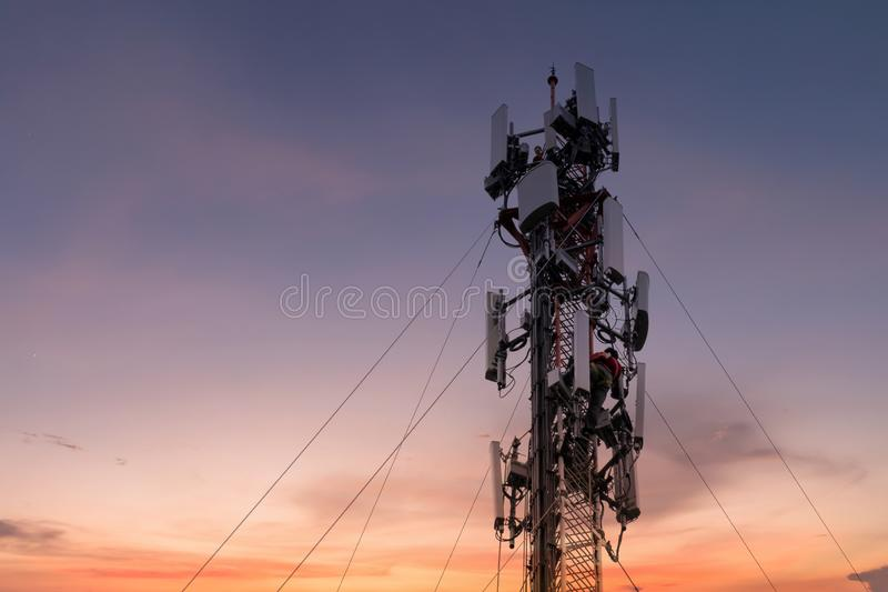 Engineer or Technician working on high tower,Risk work of high work, people are working with safety equipment on tower, royalty free stock photography