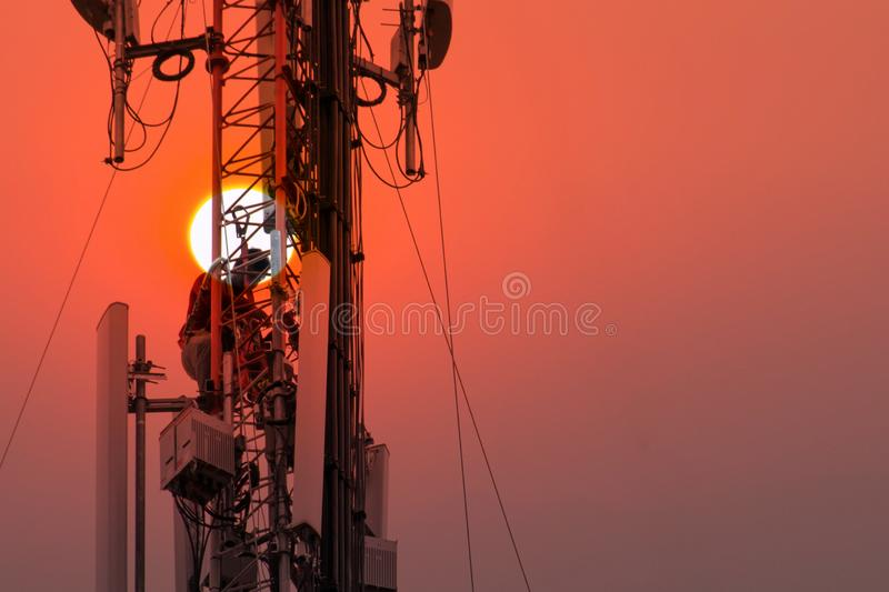 Engineer or Technician working on high tower,Risk work of high work, people are working with safety equipment on tower,. Telecommunication, background stock images