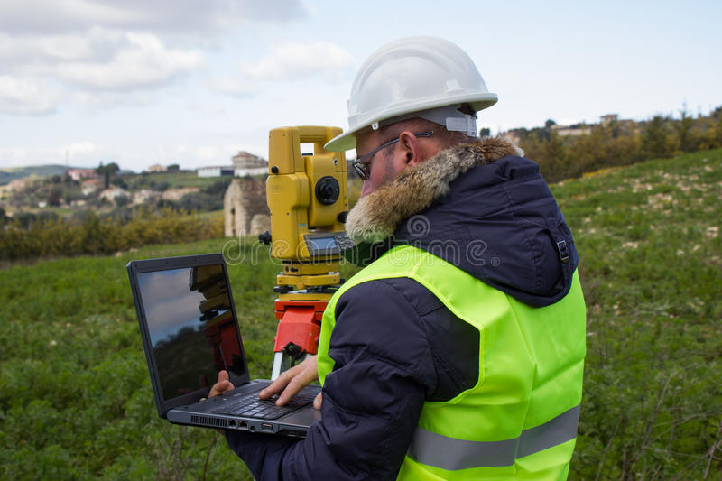Engineer with theodolite royalty free stock image