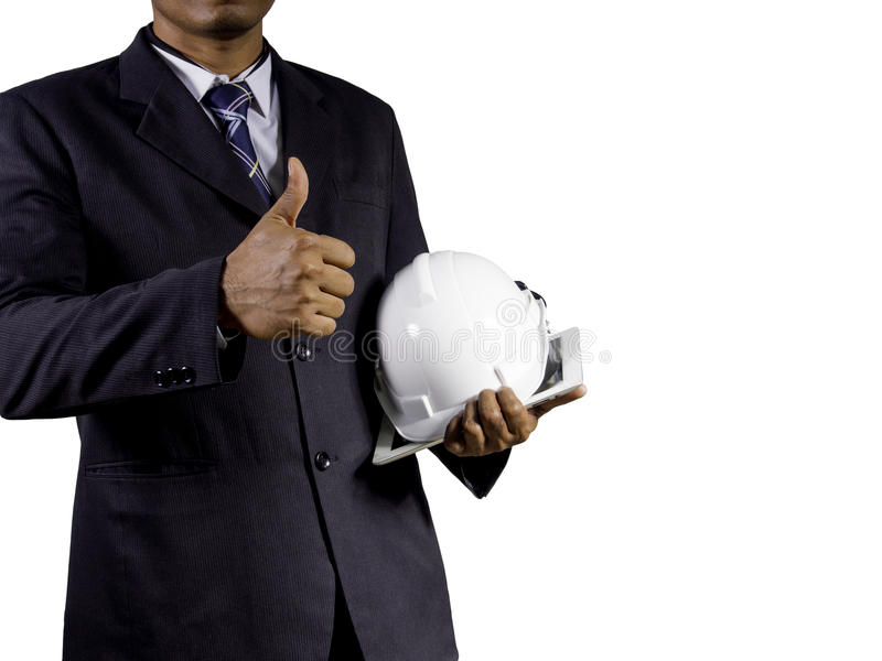 Engineer thumb up while holding helmet and tablet on white background with copy space. For safety use stock photo