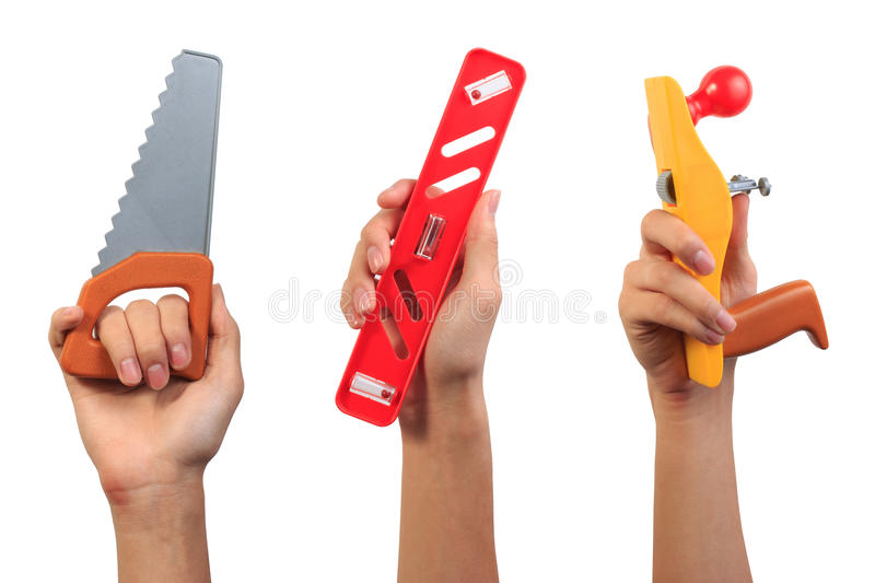 Engineer tool toy concept. Boy hand holding saw tool, water level tool and carpenter plane tool toy. Engineer tool toy concept. Boy hand holding saw tool, water stock photo