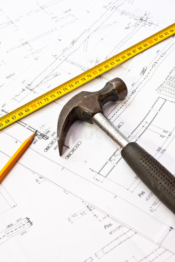 Engineer tools - hammer. Hammer with enginner plans and construction tools royalty free stock images