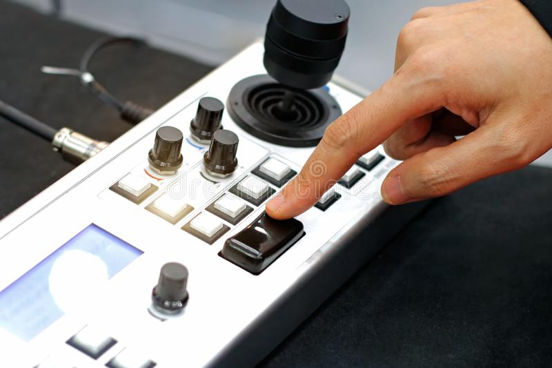 Engineer Uses Machine Control panel, buttons and joystick in factory. Engineer Uses Machine Control panel buttons and joystick in factory royalty free stock photos