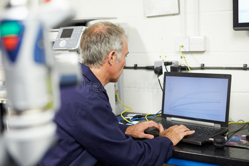 Engineer Using Computerized CMM Arm In Factory stock photos