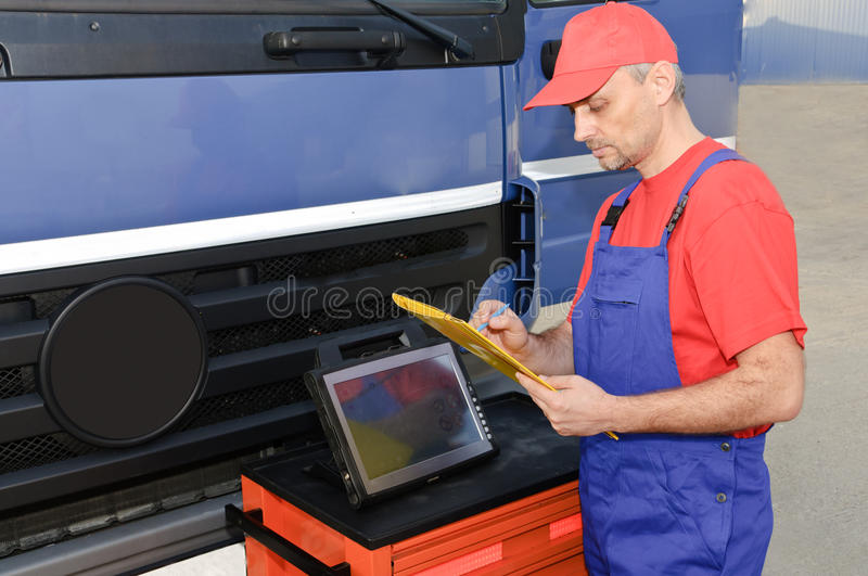 Download Engineer Using Diagnostic Equipment Stock Photo - Image of control, bonnet: 17101516