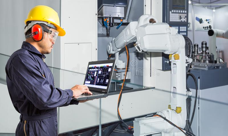 Engineer using laptop computer for maintenance automatic robotic stock image