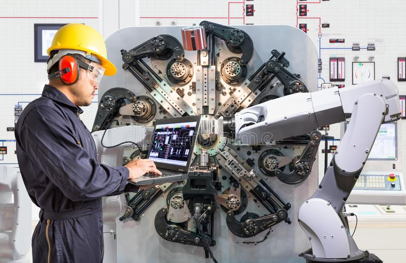 Engineer using laptop computer for maintenance robotic industry stock photos