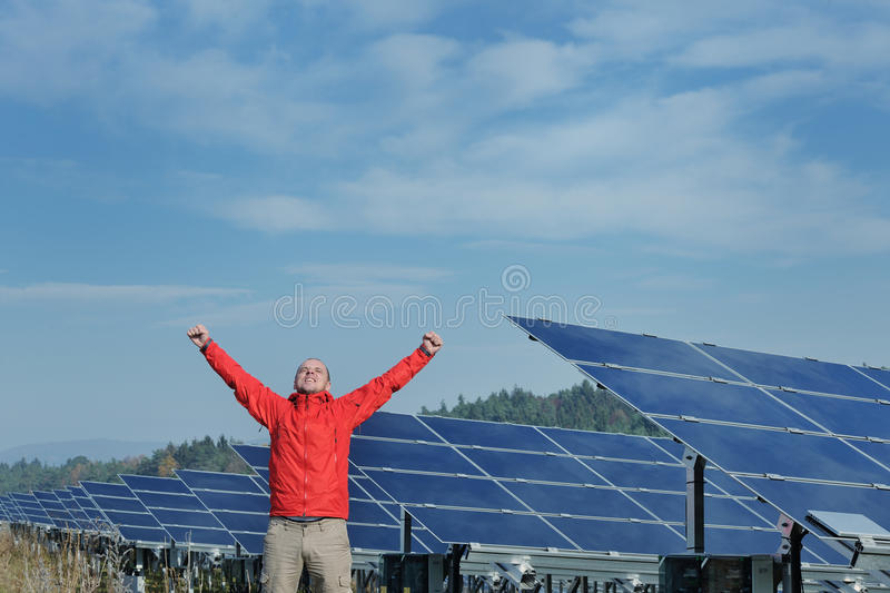 Engineer using laptop at solar panels plant field royalty free stock images