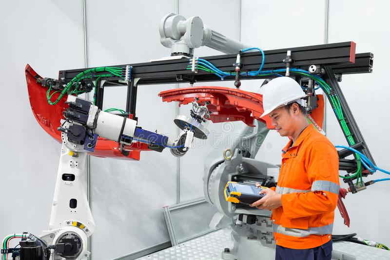 Engineer using measurement tool inspect industrial robot grip automotive workpiece, Smart factory concept royalty free stock image