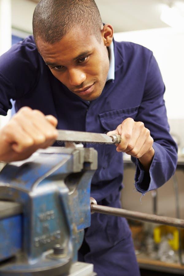 Engineer Using Metal File On Factory Floor. Close Up Of Engineer Using Metal File On Factory Floor stock image