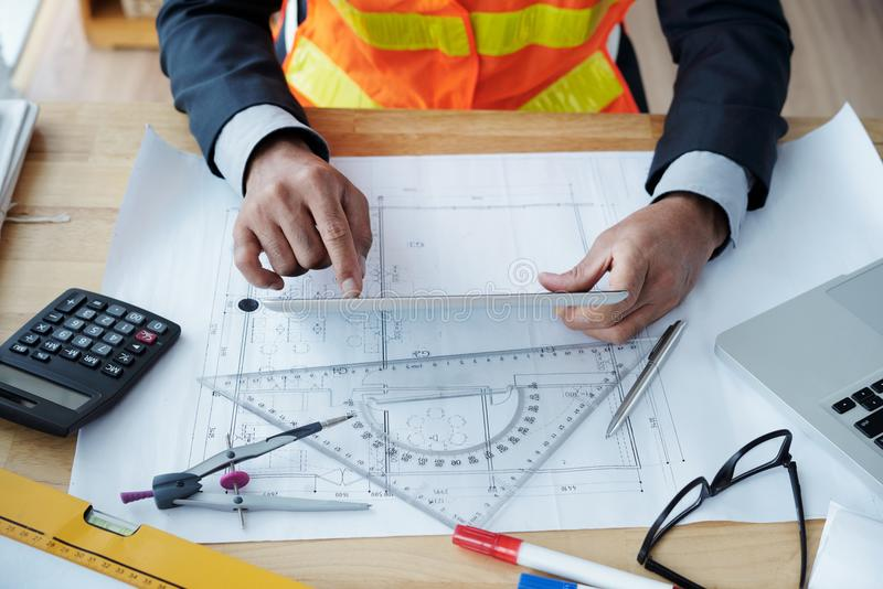 Engineer working on construction project stock images